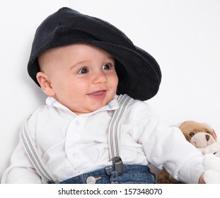 Laughing baby wearing French beret