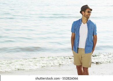 Laughing beach guy in shorts and shirt
