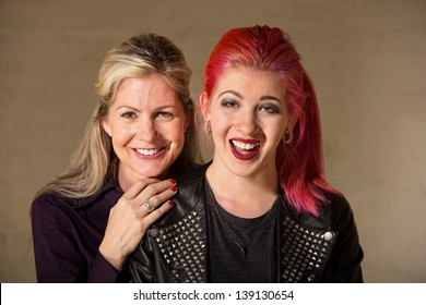 Laughing beautiful European mother and daughter indoors