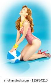 b12d3eec0fb2b Laughing beautiful girl pin-up in a pink bikini with beach ball