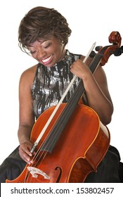 Laughing Black female classical musician with cello