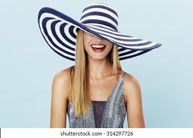 Laughing blond woman in summer hat