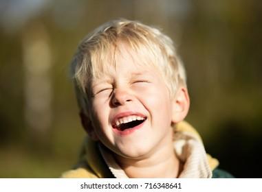 Laughing blonde toddler boy