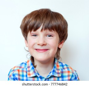 The laughing boy 6 years old, portrait, close, blond hair, plaid shirt