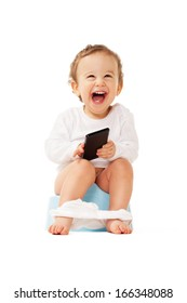 Laughing boy with smartphone sitting on the pot on isolated white