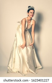 Laughing bride in a white wedding dress. Bride laughing expressively during the photo session.