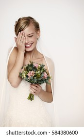 Laughing bride in white wedding dress