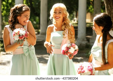 The laughing bridesmaids with bouquet