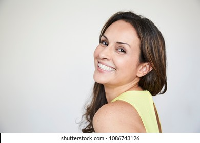 Laughing brunette looking at camera