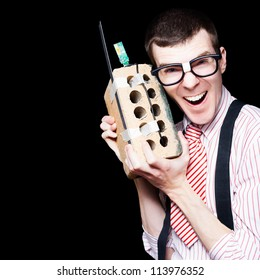 Laughing Business Geek Talking On A Mobile House Brick Telephone In A Funny Depiction Of The Wireless Technology Evolution