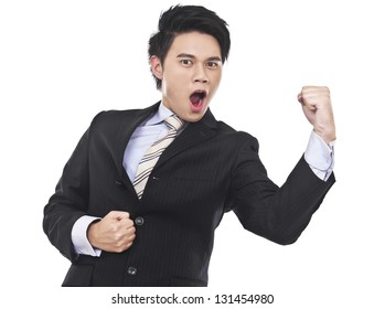 Laughing businessman with hand clenched as fist. victory, success, a winner in business.