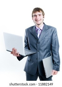 Laughing businessman with two laptops, isolated on white background