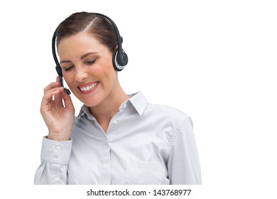 Laughing businesswoman with headset looking down