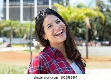 Laughing caucasian woman in hipster shirt