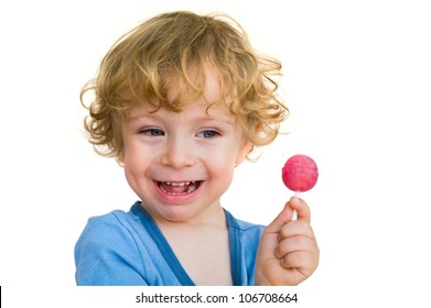 Laughing child with lollipop