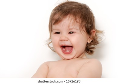 Laughing the child on a light background