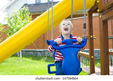 laughing child on a swing