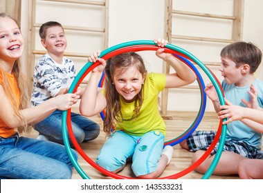 Laughing children playing in a gym