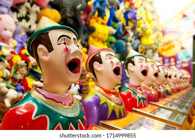 Laughing clowns, a sideshow alley game at the fair