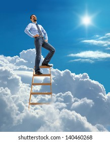 Laughing confident businessman standing at the top of ladder high in the sky