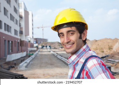 Laughing construction worker with black hair