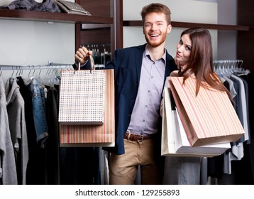 Laughing couple after shopping at the store
