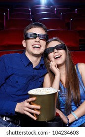 Laughing couple in cinema