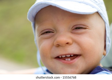 Laughing cute baby boy portrait