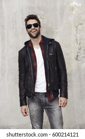 Laughing dude in leather jacket, studio