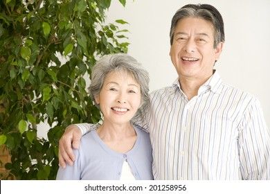 A laughing elderly couple