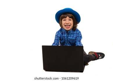 Laughing executive boy in front of laptop isolated on white background