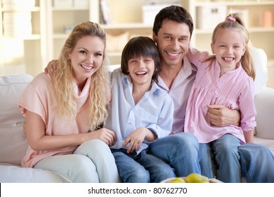 Laughing families with children at home