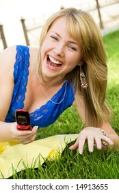 laughing girl with a cellphone