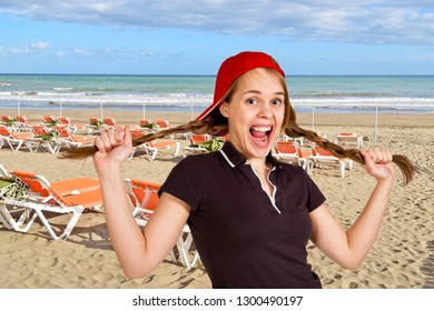 A laughing girl on the sand beach