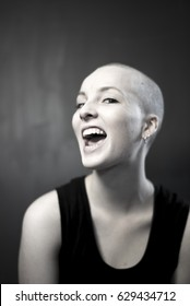 Laughing girl with shaved head