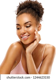 Laughing girl touching her face. Photo of african girl with flawless skin on white background. Skin care and beauty concept