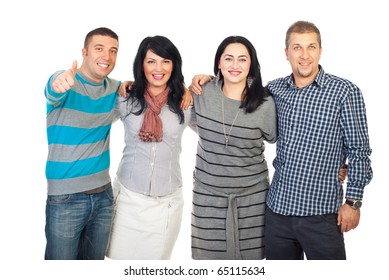 Laughing group of friends standing in a long embrace and one man giving thumb up isolated on white background
