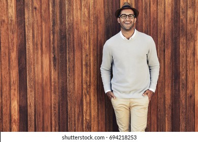 Laughing guy in glasses and hat, portrait