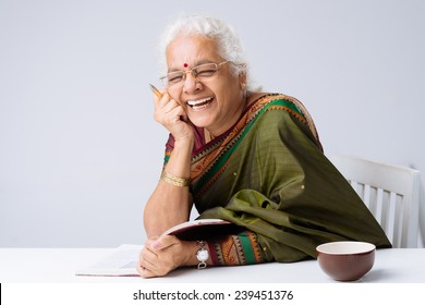 Laughing Indian woman with a book