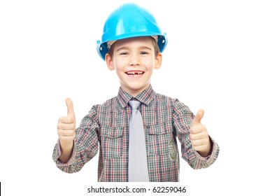 Laughing kid with blue hard hat giving thumbs up isolated on white background
