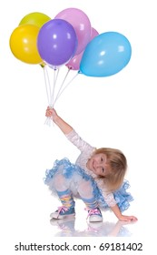 A laughing kid in blue is playing with balloons; isolated on the white background