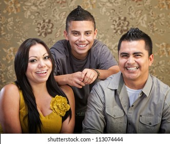 Laughing Latino family with son, mother and father