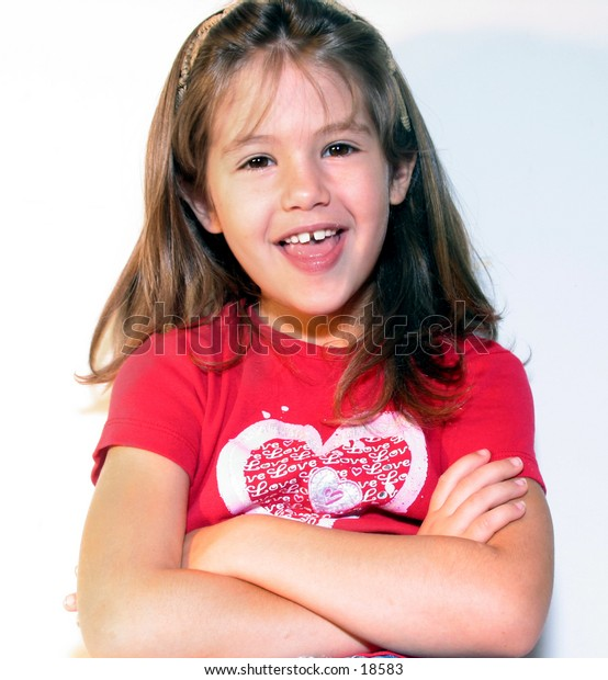 laughing little girl with arms crossed