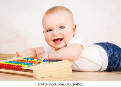 Laughing little toddler playing with abacus