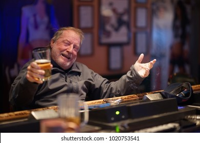 Laughing Man At The Bar Having A good Time Drinking Alcohol