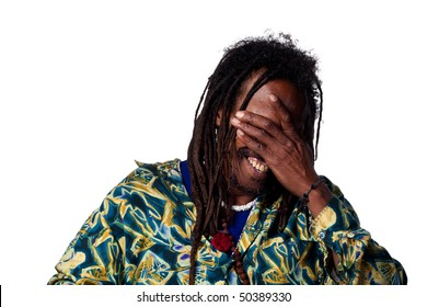 Laughing man covers his face, finds something very funny