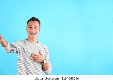 Laughing man taking selfie on color background. Space for text