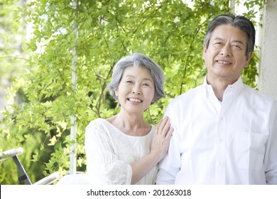 A laughing middle-age couple