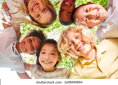 Laughing multicultural kids in circle as integration concept