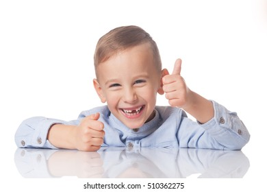 Laughing positive boy with the thumb up on isolated white